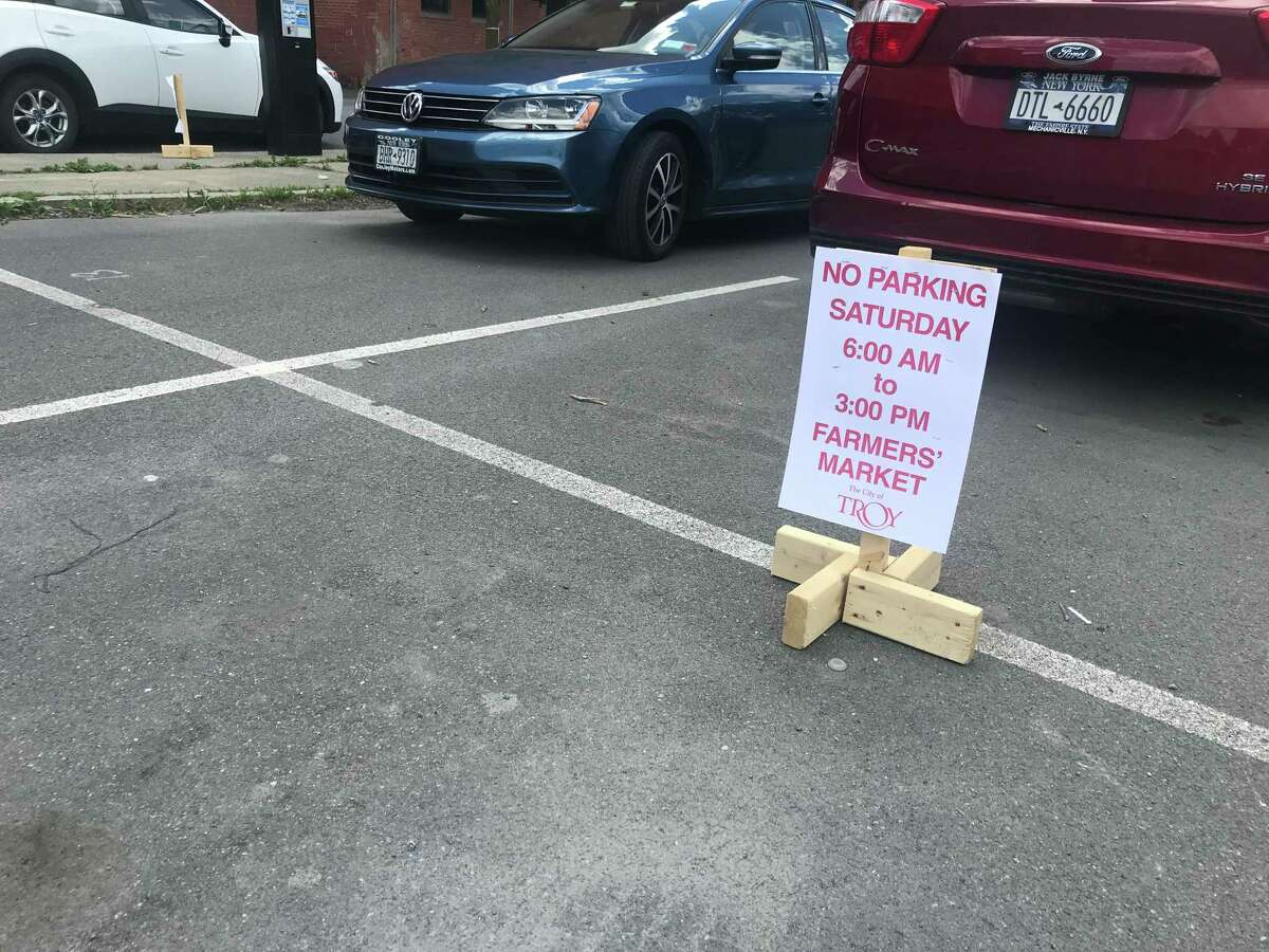 A no parking sign put in place for the Troy Waterfront Farmers Market on Friday afternoon in Troy, NY. The market opens Saturday June 13, 2020 for the first time this year in Riverfront Park. The market spent May in a parking lot on the Russell Sage College campus.