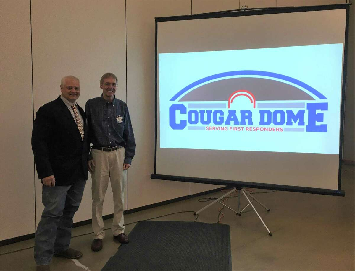 Last Wednesday Conroe Noon Lions Club President, Scott Perry, left, visits with speaker Dr. Glenn Slater, right, after the club meeting about the FEMA - Safe Room facility for first responders granted to Covenant Christian School.
