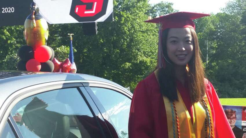 Pomperaug senior and Valedictorian Michelle Lu at Pomperaug High graduation on Friday. Valedictorian Michelle Lu, who will be studying chemistry and physical biology at the University of Hartford, couldn't have been happier with the event.