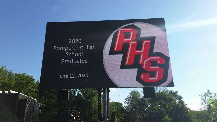 Pomperaug High graduation electronic sign. All the speakers and videos were shown on a large digital screen behind the stage. After senior Tayor Dembski sang the