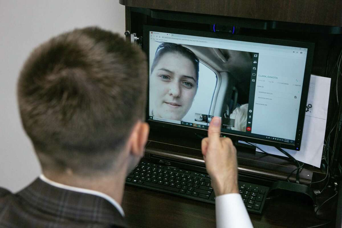 Dr. Matthew Harting speaks to his patient's mother Kathleen Clark during a telemedicine appointment at UT Physicians on June 08, 2020.