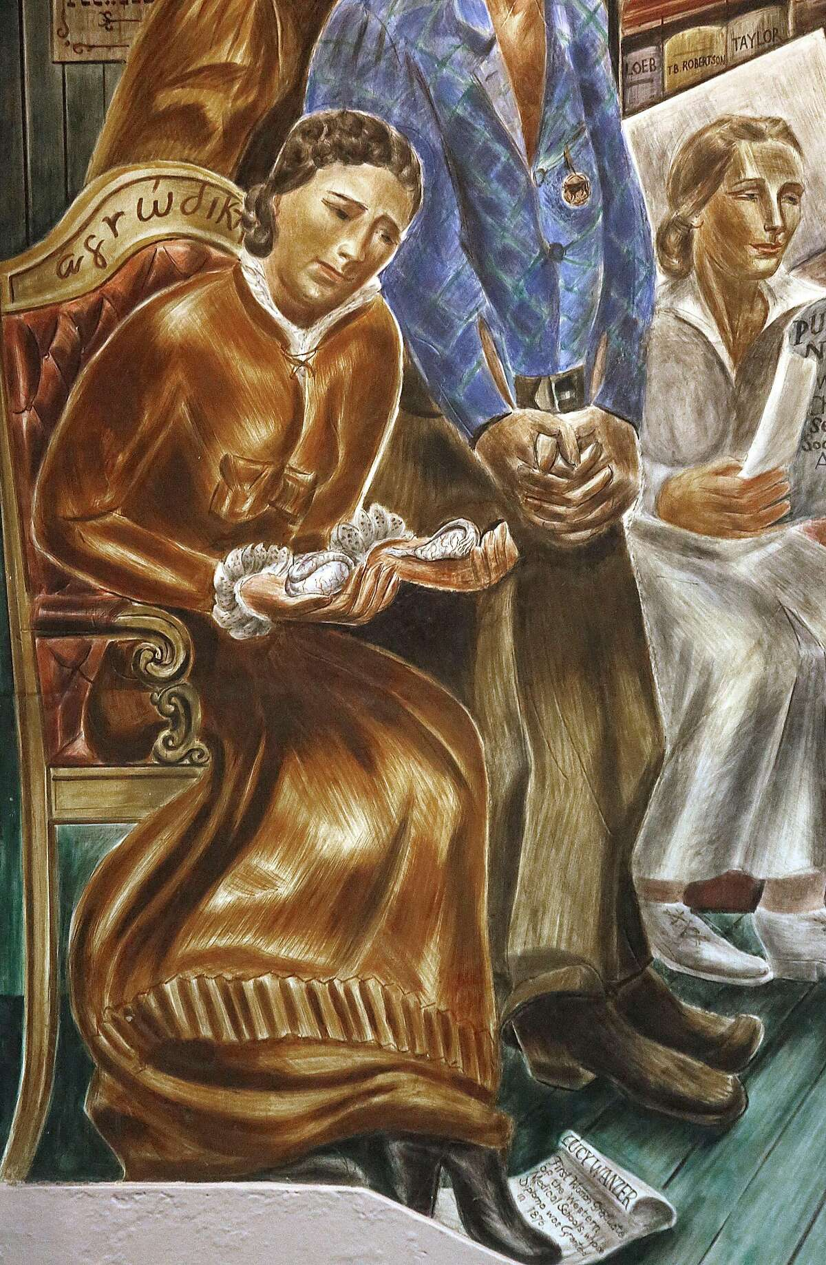 Lucy Wanzer is in a mural painted by artist Bernard Zakheim seen in Toland Hall at UCSF Parnassus campus in San Francisco, California on Friday, February 27, 2015. Wanzer who graduated from UCSF in 1876, was the first woman graduate in the medical field. Her school application was initially rejected and is seen carrying ovaries in one hand and testis in the other.