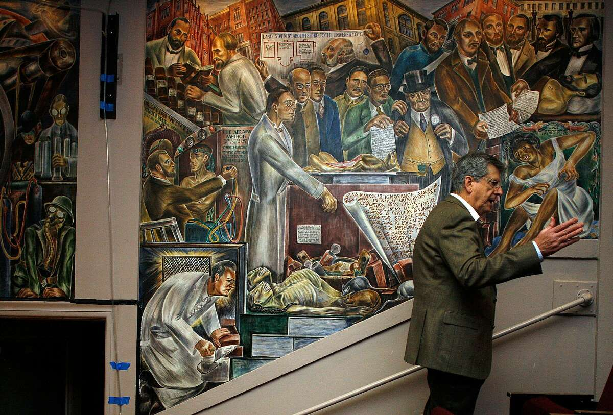 Professor Robert Schindler talks about the murals painted by artist Bernard Zakheim in Toland Hall at UCSF Parnassus campus in San Francisco on Friday, Feb 27, 2015.