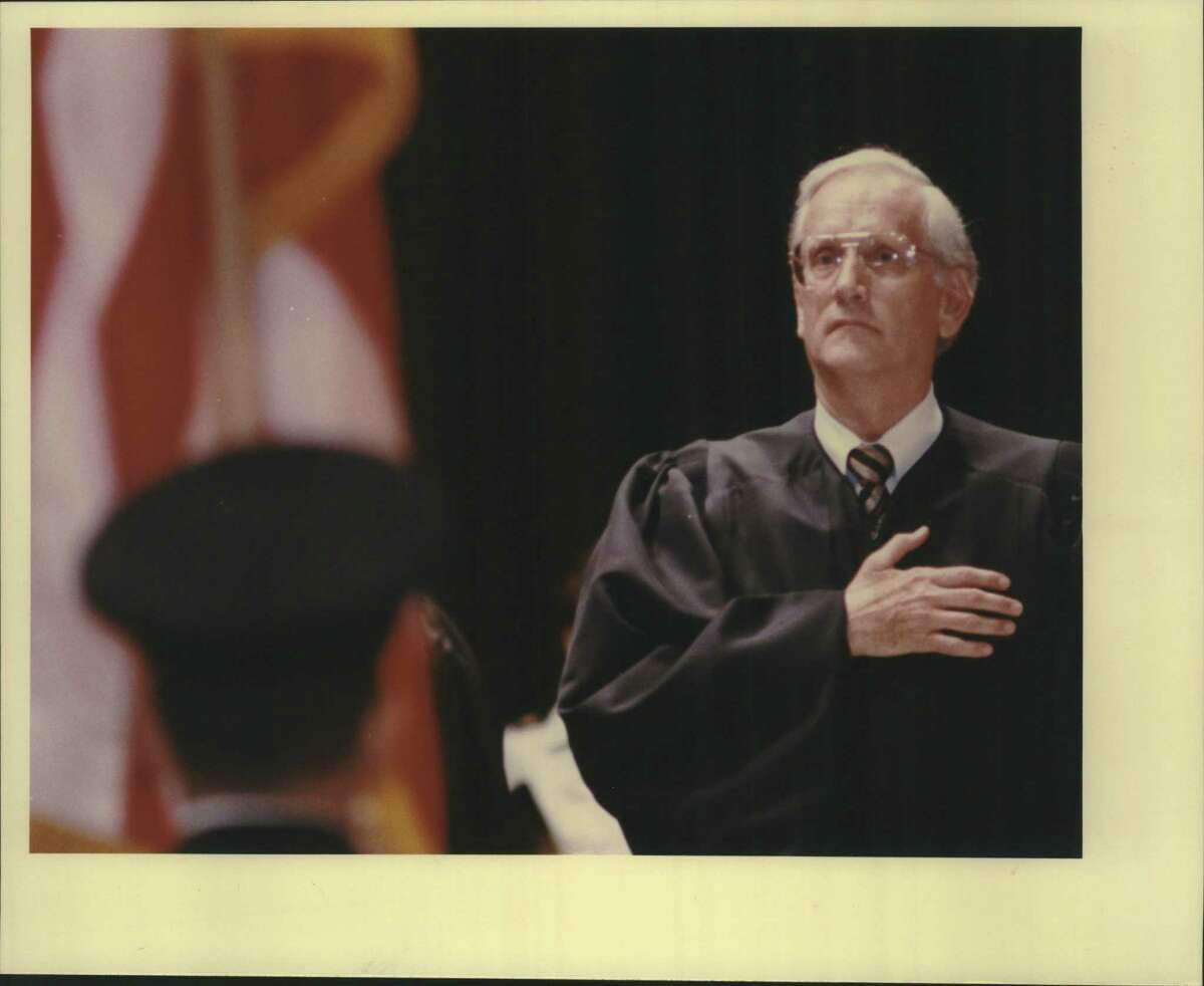 Judge William Sessions says pledge of allegiance during mass swearing in ceremonies at Trinity University. He left the federal bench in 1987 to become FBI director.
