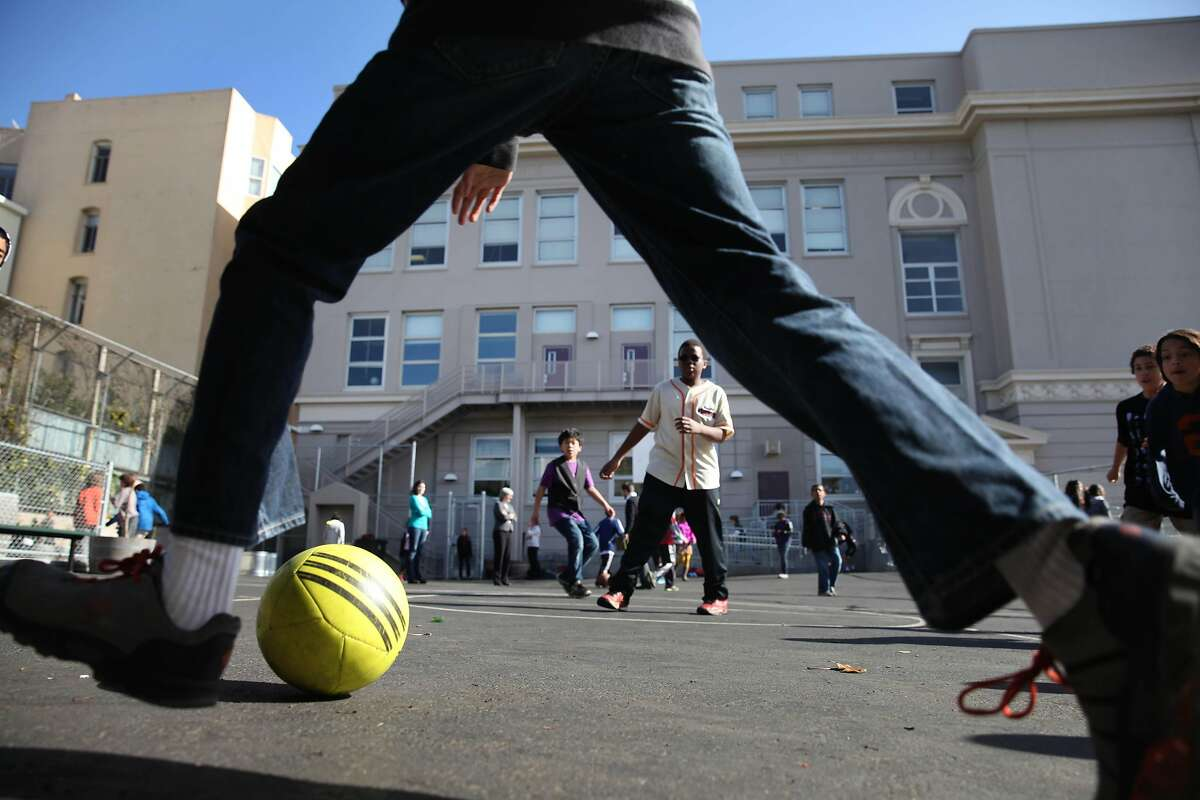 Sixth graders play during recess at Gateway Middle School on Thursday, February 7, 2013 in San Francisco, Calif.