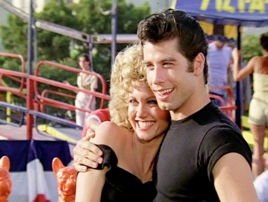 """Bow Tie Cinemas plans to reopen its theaters in Connecticut on June 17, with enhanced cleaning and safety protocols. It will be showing classic favorite movies for $5, including """"Grease,"""" starring Olivia Newton-John and John Travolta. New Hollywood films will be available as early as July 1 at regular prices. Photo: CBS Photo Archive / Getty Images / 1978 CBS Photo Archive"""