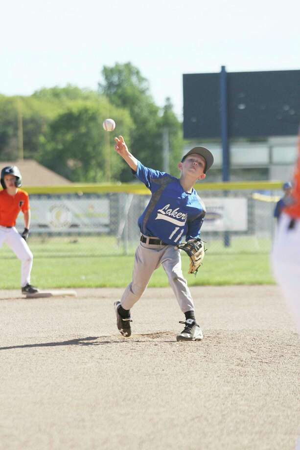 Bennett Zeller delivers a pitch for the Lake Michigan Lakers' 9-U team last season. (News Advocate file photo)