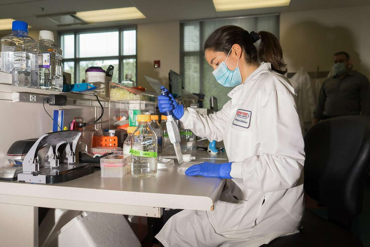 Dr. Katharina Roeltgen cleans COVID-19 antibody tests at the Stanford Clinical Virology Lab in Palo Alto, Calif. on Friday, June 12, 2020. The lab is doing antibody tests to try to neutralize COVID-19.