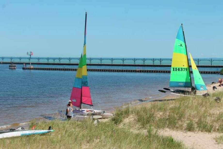 Racers prepared to launch their catamarans from the shore near First Street Beach during the Catamaran Racing Association of Michigan's 54th season last year and its third year of hosting a race in Manistee. On Tuesday, Manistee City Council could approve a request for the use of Douglas Park for the event for the fourth year. (File photo)