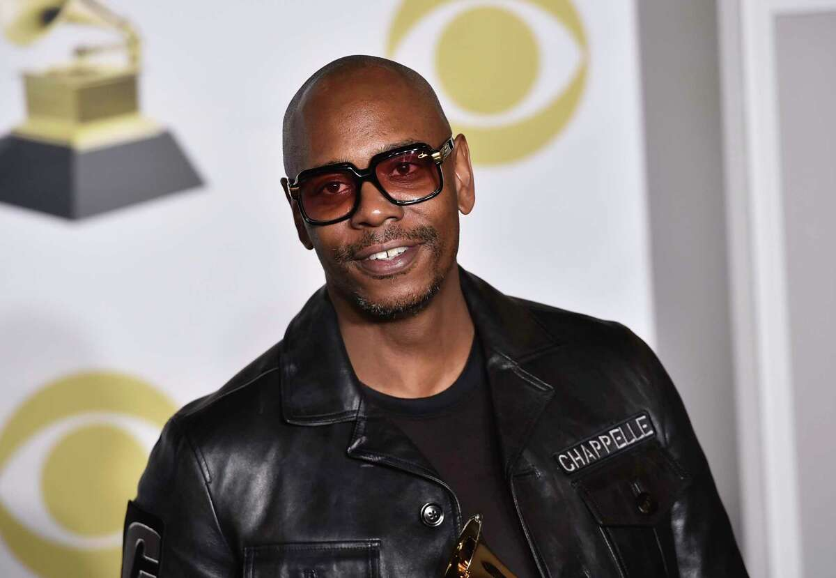 FILE - In this Jan. 28, 2018 file photo, Dave Chappelle poses in the press room with the best comedy album award for