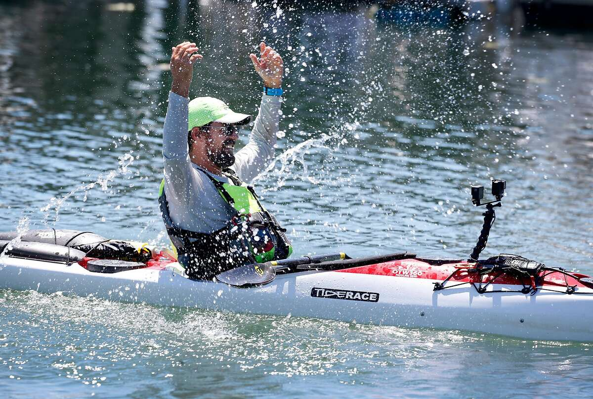 Cyril Derreumaux makes a splash when he arrives at the Sea Trek dock to complete a nine day paddling expedition in Sausalito, Calif. on Tuesday, June 9, 2020. Derreumaux completed a week-and-a-half long kayak journey from Redding to Sausalito paddling all the way down the Sacramento River and into the bay.