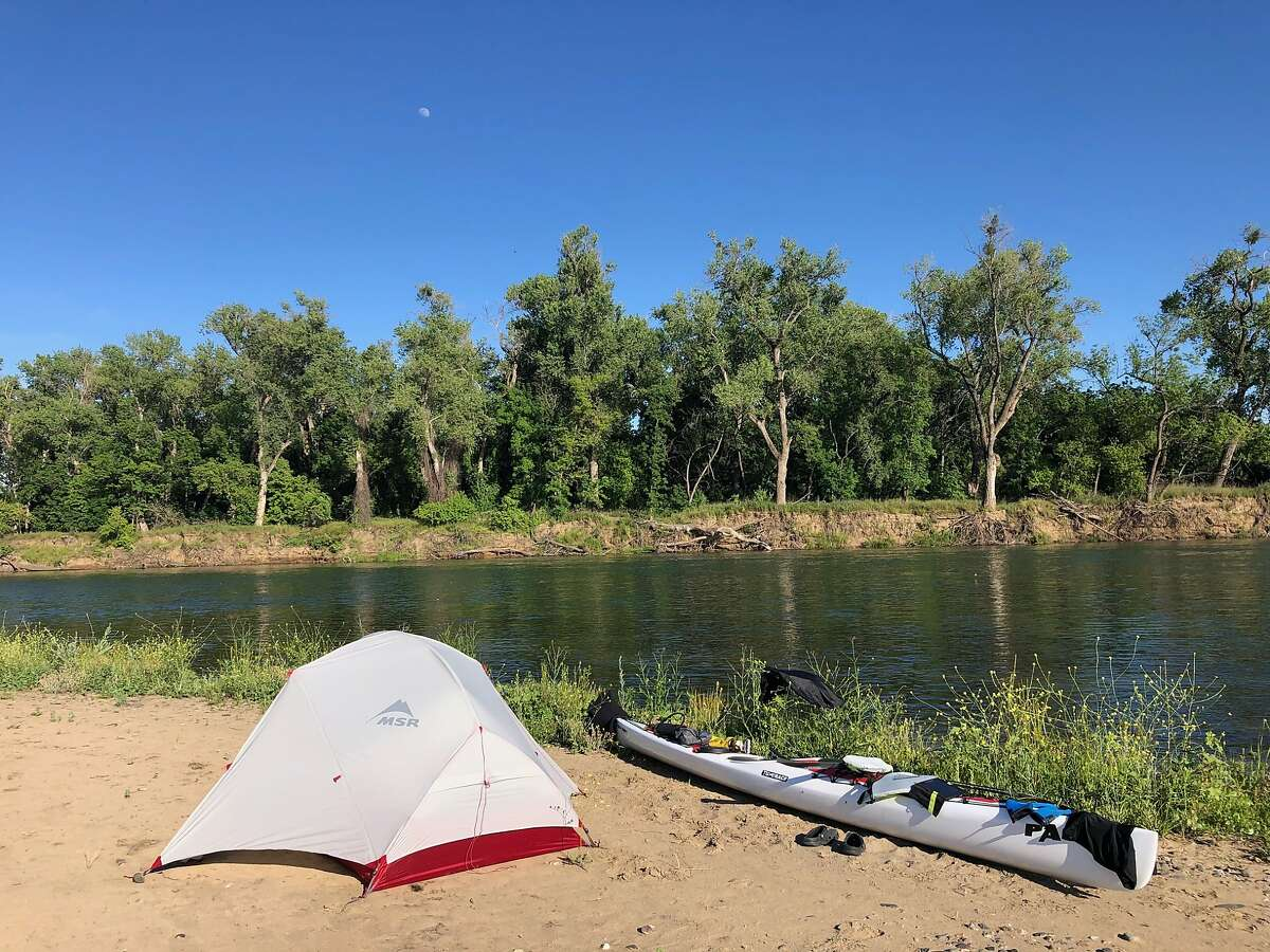 Kayaker Cyril Derreumaux's camp on a sandbar along the Sacramento River.