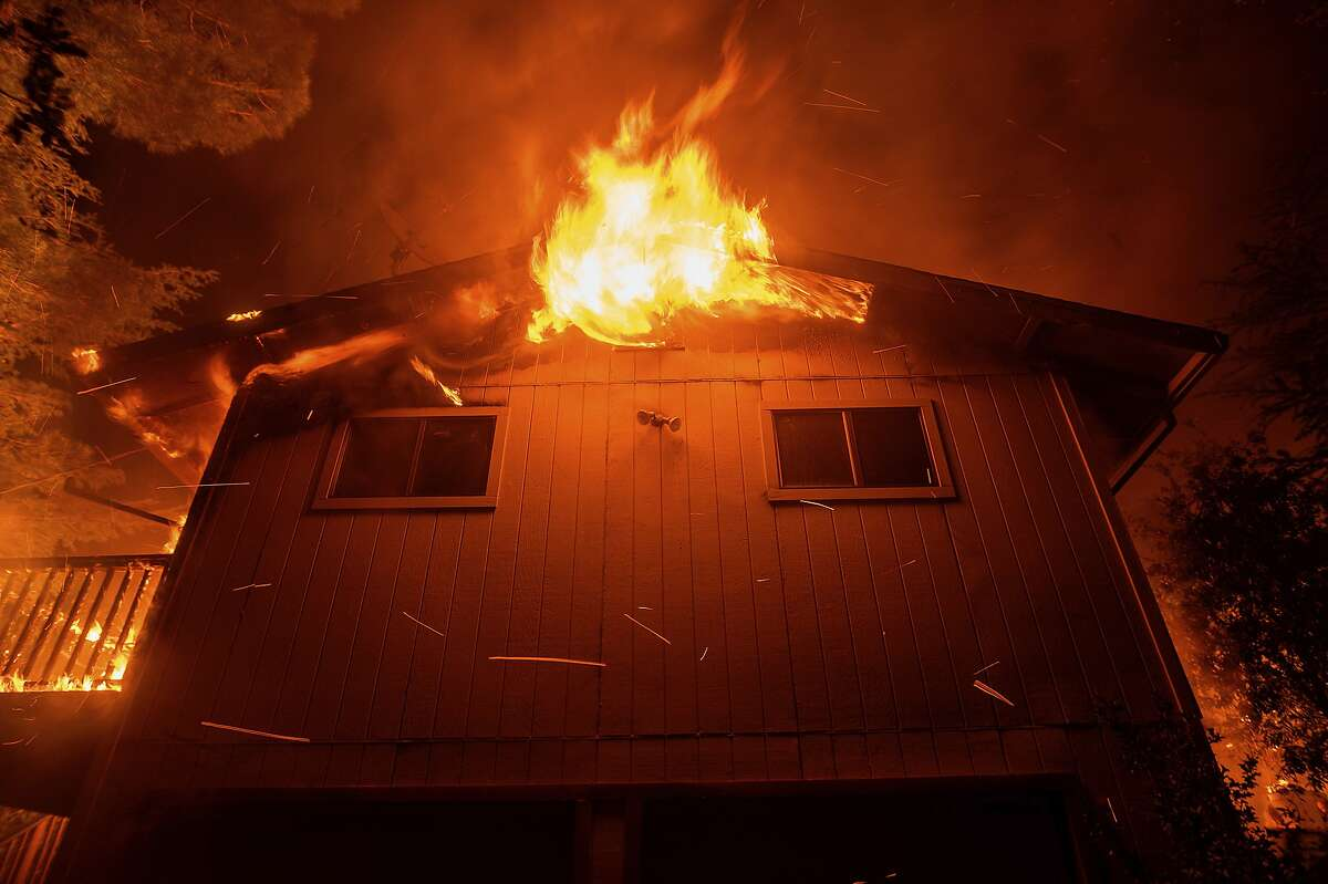 Flames consume a home as the Quail Fire burns near Winters, Calif., on Sunday, June 7, 2020. The blaze has burned at least 1,200 acres according to Cal Fire. (AP Photo/Noah Berger)