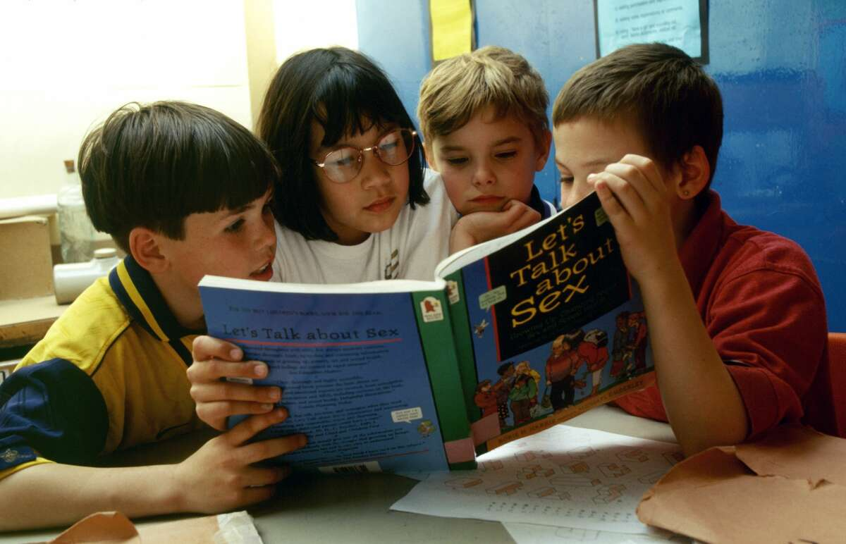 Sex education in primary school. 8 & 9 year olds reading Let's Talk About Sex book, London Borough of Greenwich UK. (Photo by: Photofusion/Universal Images Group via Getty Images)