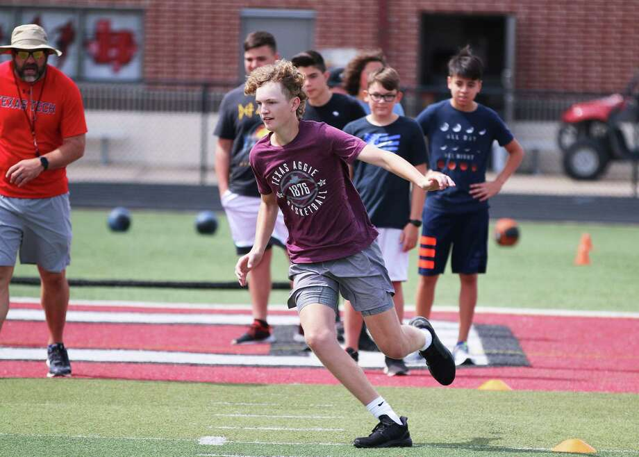 Chance Fields runs in a zig-zag pattern developing his start and stopping ability to change directions. The exercise is part of the F.A.T. Camp at Falcon Stadium in Huffman. Photo: David Taylor / Staff Photographer