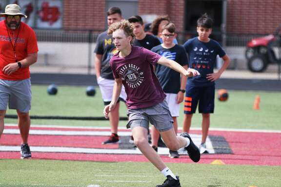 Chance Fields runs in a zig-zag pattern developing his start and stopping ability to change directions. The exercise is part of the F.A.T. Camp at Falcon Stadium in Huffman.