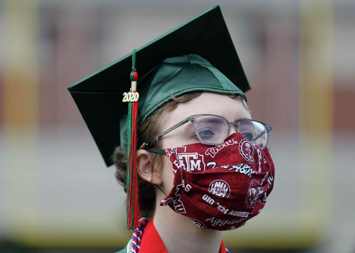 Ellen Crawford, who will attend Texas A&M, wears a face mask with the college's logo during The Woodlands High School's graduation ceremony at Woodforest Bank Stadium, Tuesday, June 2, 2020, in Shenandoah.