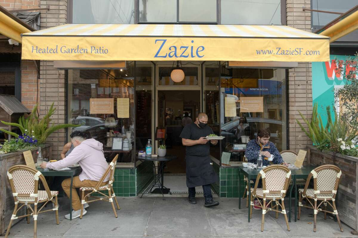 It's a Zazie that customers familiar with the Cole Valley spot won't recognize. There are only six tables on the back patio, with a plastic divider separating the back half from the front. All tables have been removed from the indoor dining room and only two tables remain out front. Sanitizing dispensers are placed throughout the restaurant and servers bustled around with masks on.
