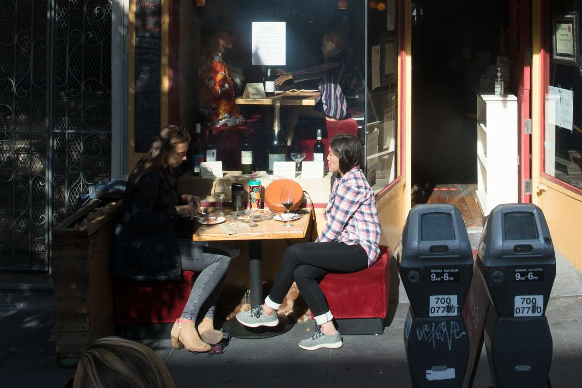 Customers dine outdoors at XXX wine bar along Valencia Street in San Francisco, Calif. on June 11, 2020. Outdoor dining will reopen in Alameda County starting Friday.