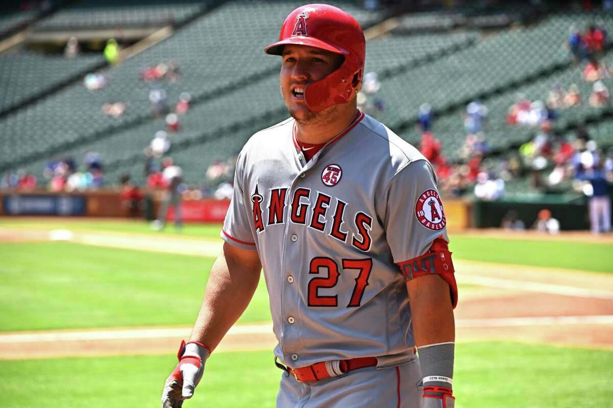 ARLINGTON, TEXAS - AUGUST 20: Mike Trout #27 of the Los Angeles Angels reacts after his two-run home run in the top of the first inning during game one of a doubleheader against the Texas Rangers at Globe Life Park in Arlington on August 20, 2019 in Arlington, Texas. (Photo by C. Morgan Engel/Getty Images)