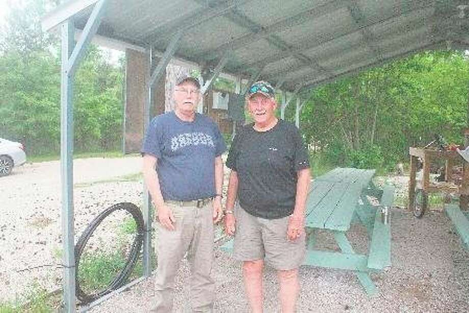 Lake County Sportsman Club members John Beach (left) and Bud Kloosterman get ready to host Tuesday's open house at the clubgrounds. (Star photo/John Raffel)