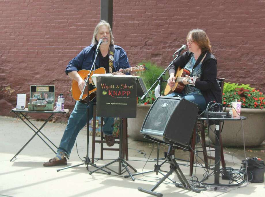 Music-lovers gathered in downtown Big Rapids for the first day of the Pocket Park Concert Series. The series was kicked off by Americana duo Wyatt and Shari, and will continue from noon to 2 p.m. each Friday through Sept. 18. (Pioneer photo/Catherine Sweeney)
