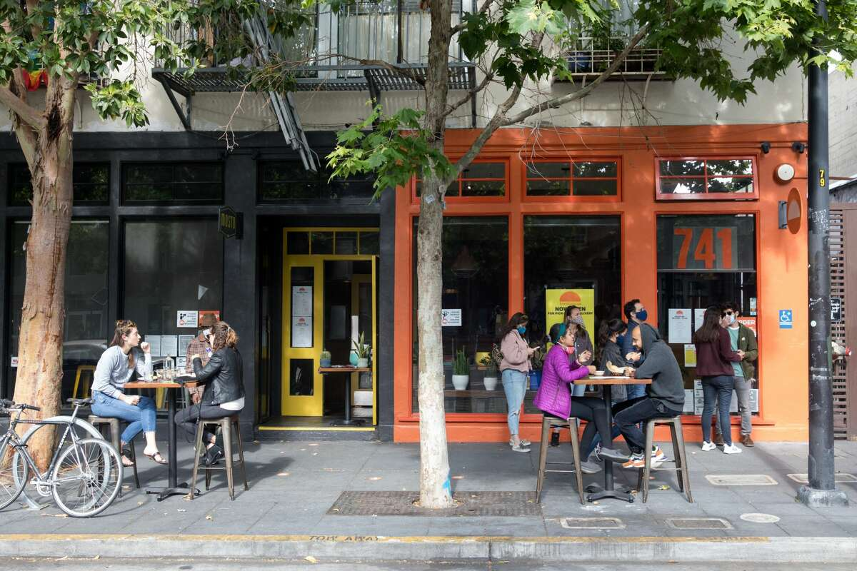 Customers sit outside at Tacolicious' Valencia Street location in San Francisco on June 12, 2020.