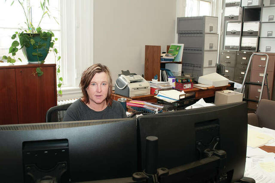 Morgan County Treasurer Jenny Geirnaeirt works in her office in March. She died Friday in a single-car accident. Photo: Darren Iozia | Journal-Courier