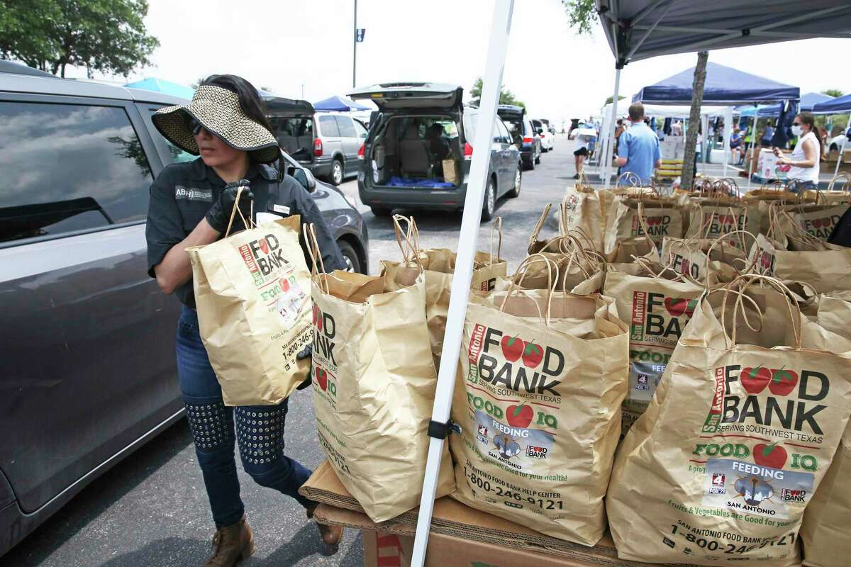 The San Antonio Food Bank gets help from volunteers at the Community Bible Church in handing out food supplies to members of the hospitality community on May 21, 2020.