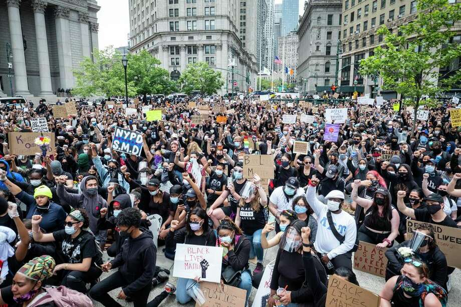 Protesters come together in Manhattan in early June. Photo: Getty Images