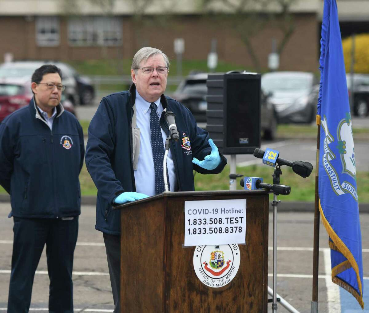 Stamford Mayor David Martin speaks about the coronavirus pandemic at the testing center at Westhill High School in Stamford, Conn. Monday, March 30, 2020.