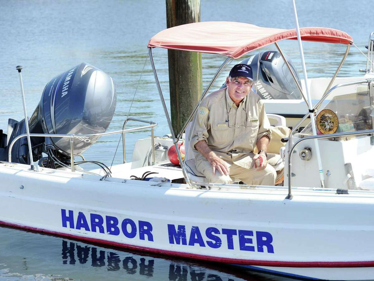 Greenwich Harbormaster Ian Macmillan aboard his motorboat at the Grass Island docks on Greenwich Harbor, Conn., Wednesday, Aug. 30, 2017.