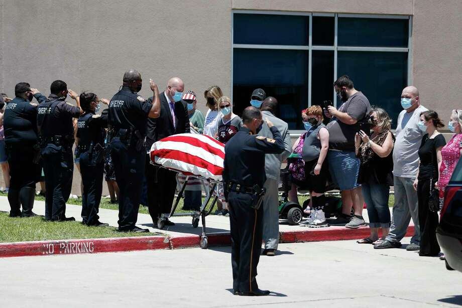 A Harris County Deputy, who passed away today from Covid-19, body was escorted from St. Luke's Patients Hospital at 4600 East Sam Houston Pkwy, in route to Crematory and Prep Center on Pine Street, Saturday, June 13, 2020. ID is pending notification of next of kin. Photo: Karen Warren, Houston Chronicle / Staff Photographer / Houston Chronicle