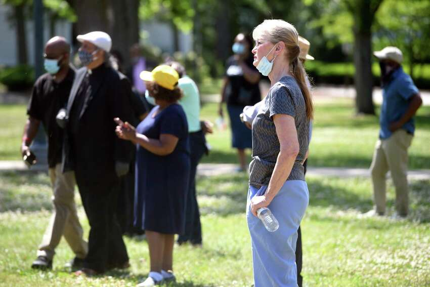 West Haven Mayor Nancy Rossi listens to speakers on the West Haven Green during a June 13, 2020 gathering to mourn the death of George Floyd at the hands of Minneapolis police and amid weeks of area protests locally and around the nation.