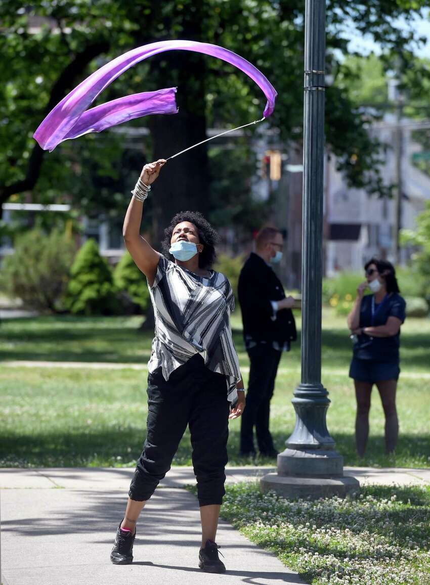 Unedra Muley of New Haven performs a liturgical dance during The Gathering in Unity Against Racism & Injustice on the West Haven Green on June 13, 2020.