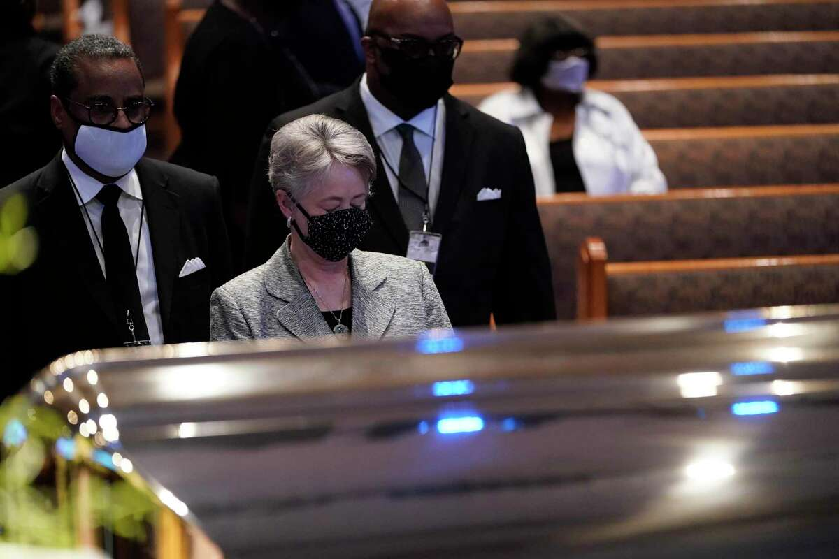 Former Houston Mayor Annise Parker pauses by the casket of George Floyd during a funeral service for Floyd at The Fountain of Praise church, Tuesday, June 9, 2020, in Houston. Floyd died after being restrained by Minneapolis Police officers on May 25.