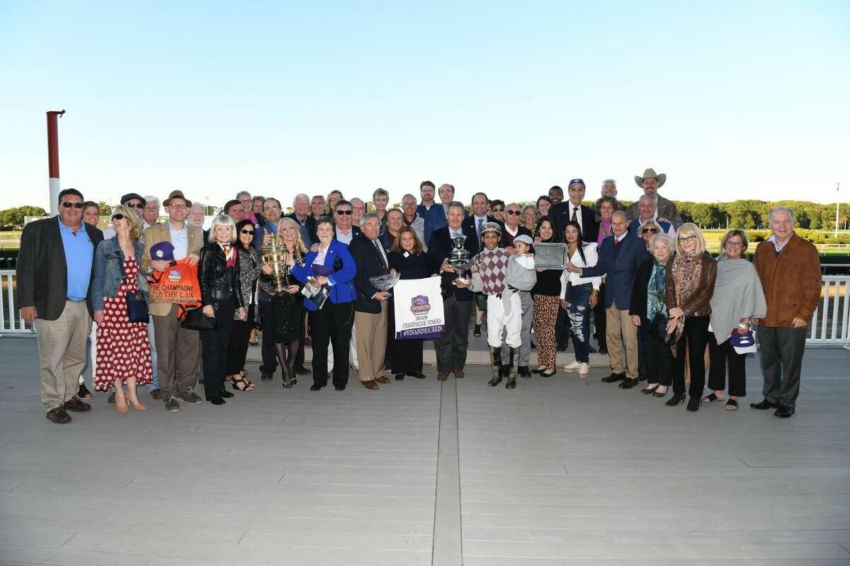 Members of Sackatoga Stable celebrate Tiz the Law's victory in the Grade I Champagne last fall. (Adam Coglianese / NYRA)