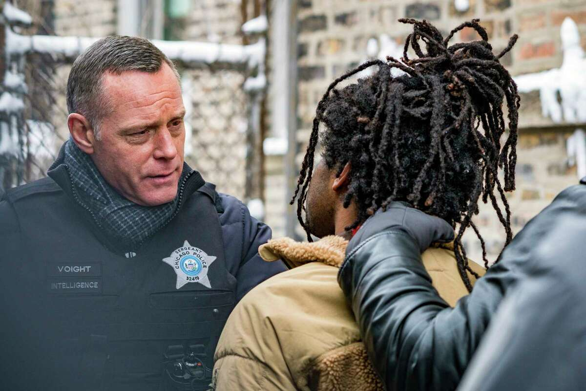 In this image released by NBC, Jason Beghe portrays Hank Voight, left, in a scene from the crime series