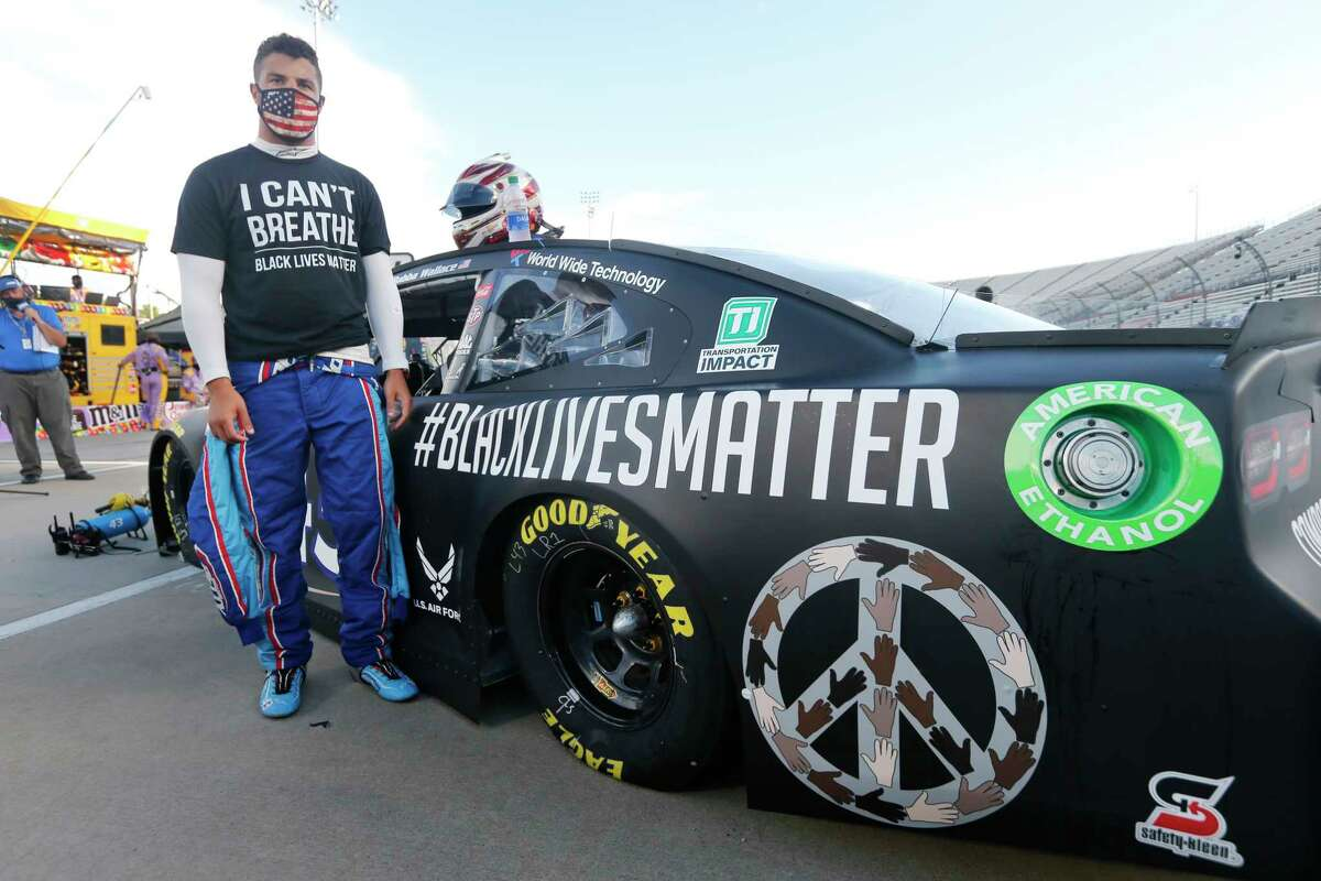 FILE - In this June 10, 2020, file photo, driver Bubba Wallace waits for the start of a NASCAR Cup Series auto race in Martinsville, Va. Bubba Wallace now counts Spike Lee and Demi Lovato a€?