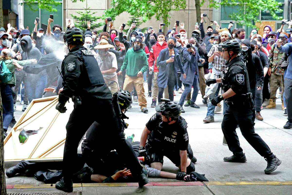 A federal judge late Friday ordered Seattle to temporarily stop using tear gas, pepper spray and flash bang devices on protests.