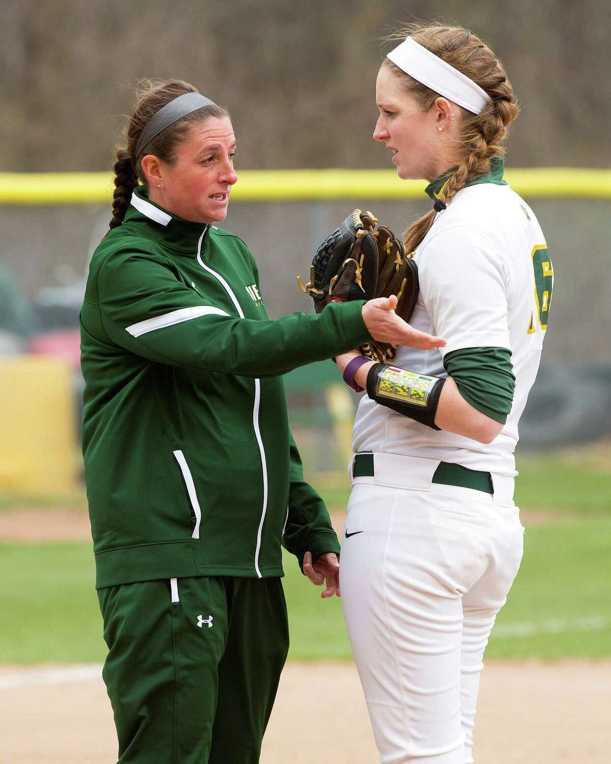 Siena softball coach Casey Bump, left, was elevated to the top spot after serving as the Saints' pitching coach for seven years. (Courtesy of Siena Athletics)