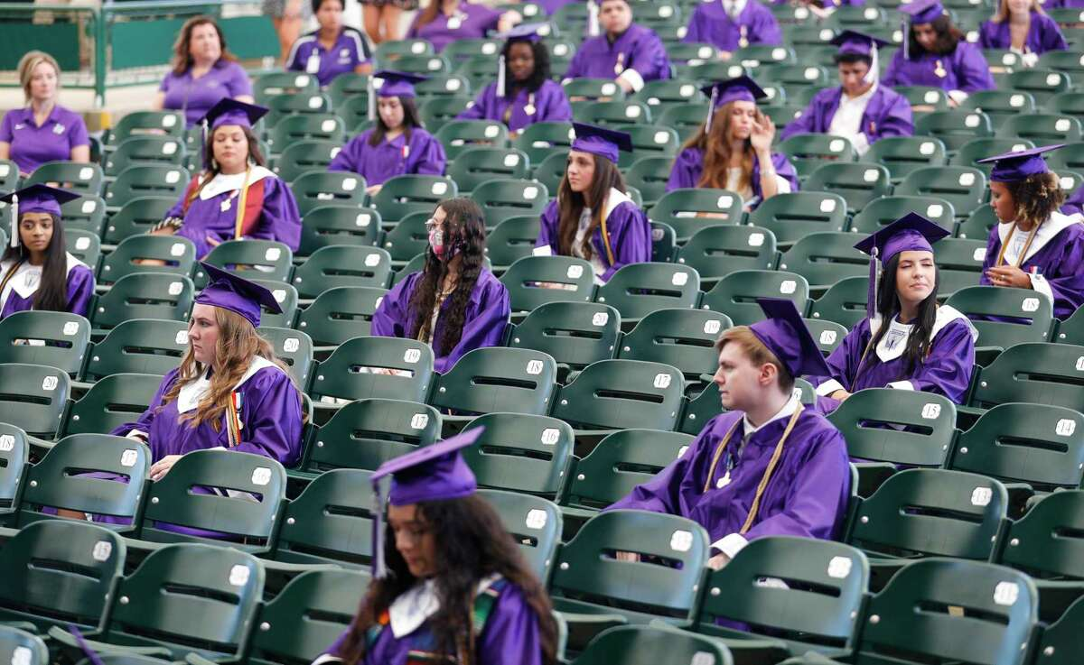 Graduates are seen spaced 6 feet apart during Willis High School's graduation ceremony.