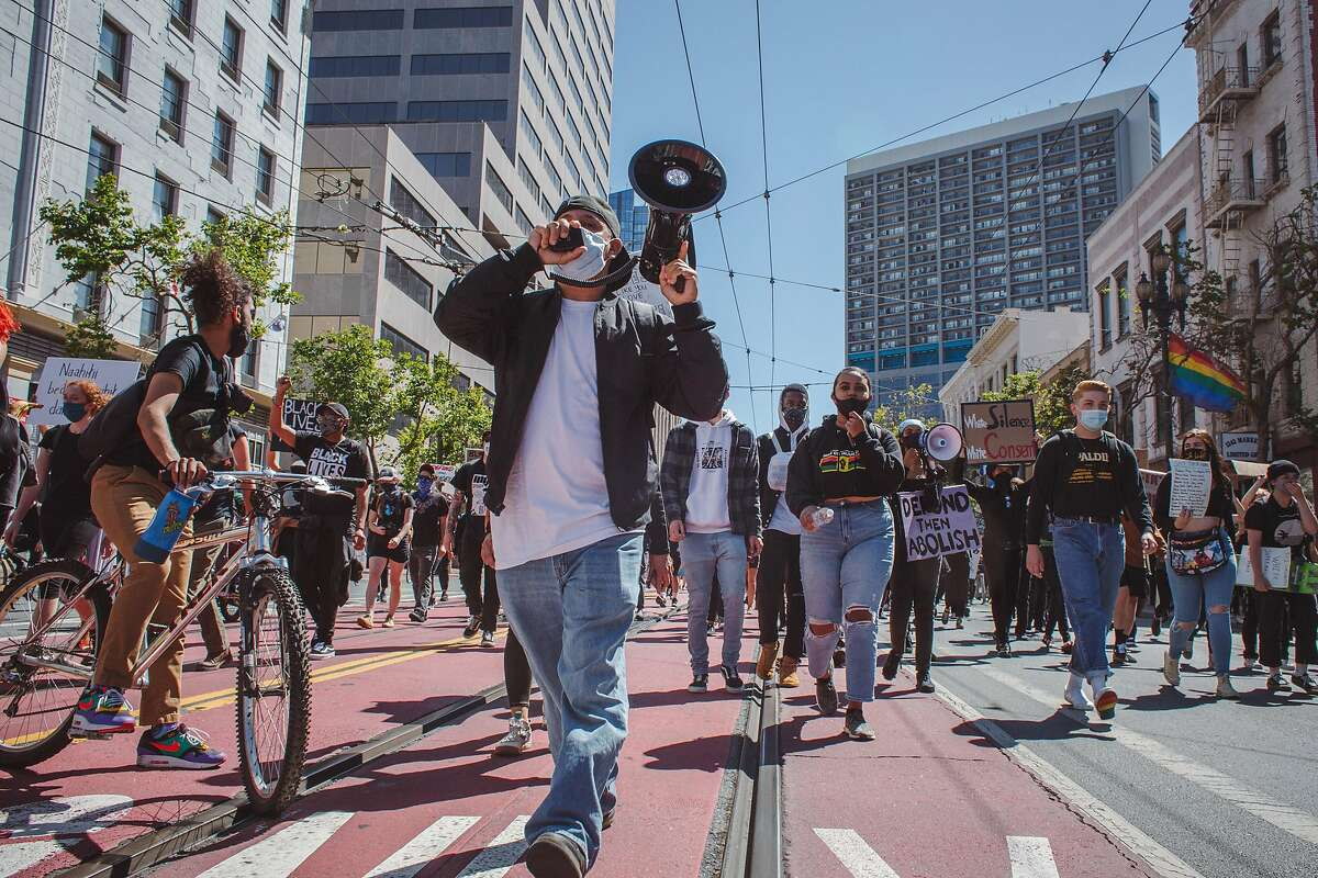 Demonstrators make their way toward City Hall in San Francisco on Saturday during a march in support of the Black Lives Matter movement.