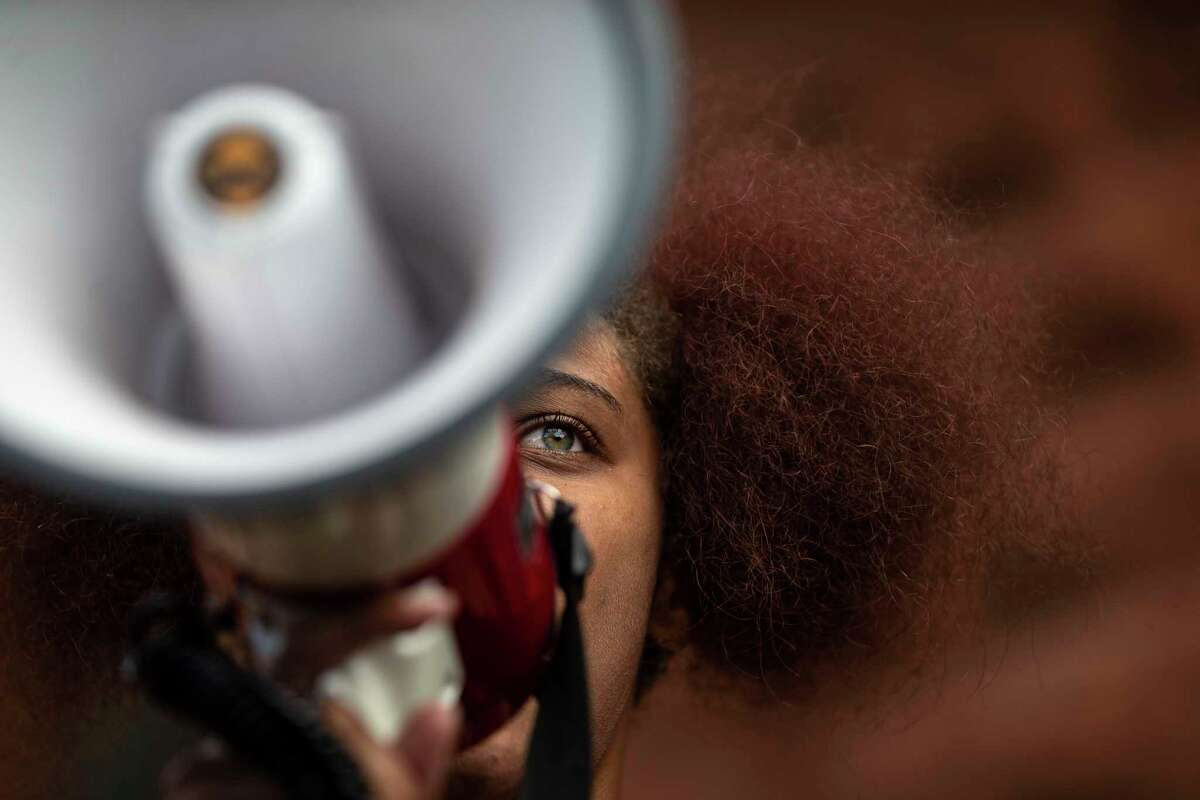 Lexi Qaiyyim addresses protesters outside the Bexar County Courthouse in downtown San Antonio on June 4, 2020. It was the sixth day of protests spurred by the death of a black man, George Floyd, in Minneapolis, on May 25, while he was being arrested by white police officers.