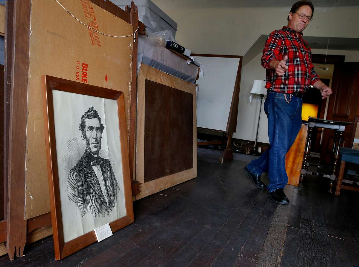 Museum docent Mike Stenberg walks past a portrait of General Braxton Bragg, which is not displayed to the public, in an upstairs storage area Tuesday July 21, 2015. There is little public support for a name change for Fort Bragg, California after various African American groups objected to the naming after a Confederate army general, Braxton Bragg.