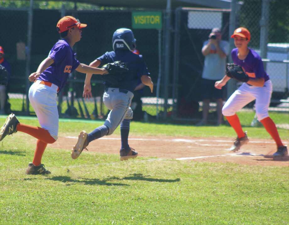Clemson's defense tags out a Texas Tribe runner who got hung up between third and home during Saturday's first of five games for NASA Pony. Photo: Robert Avery