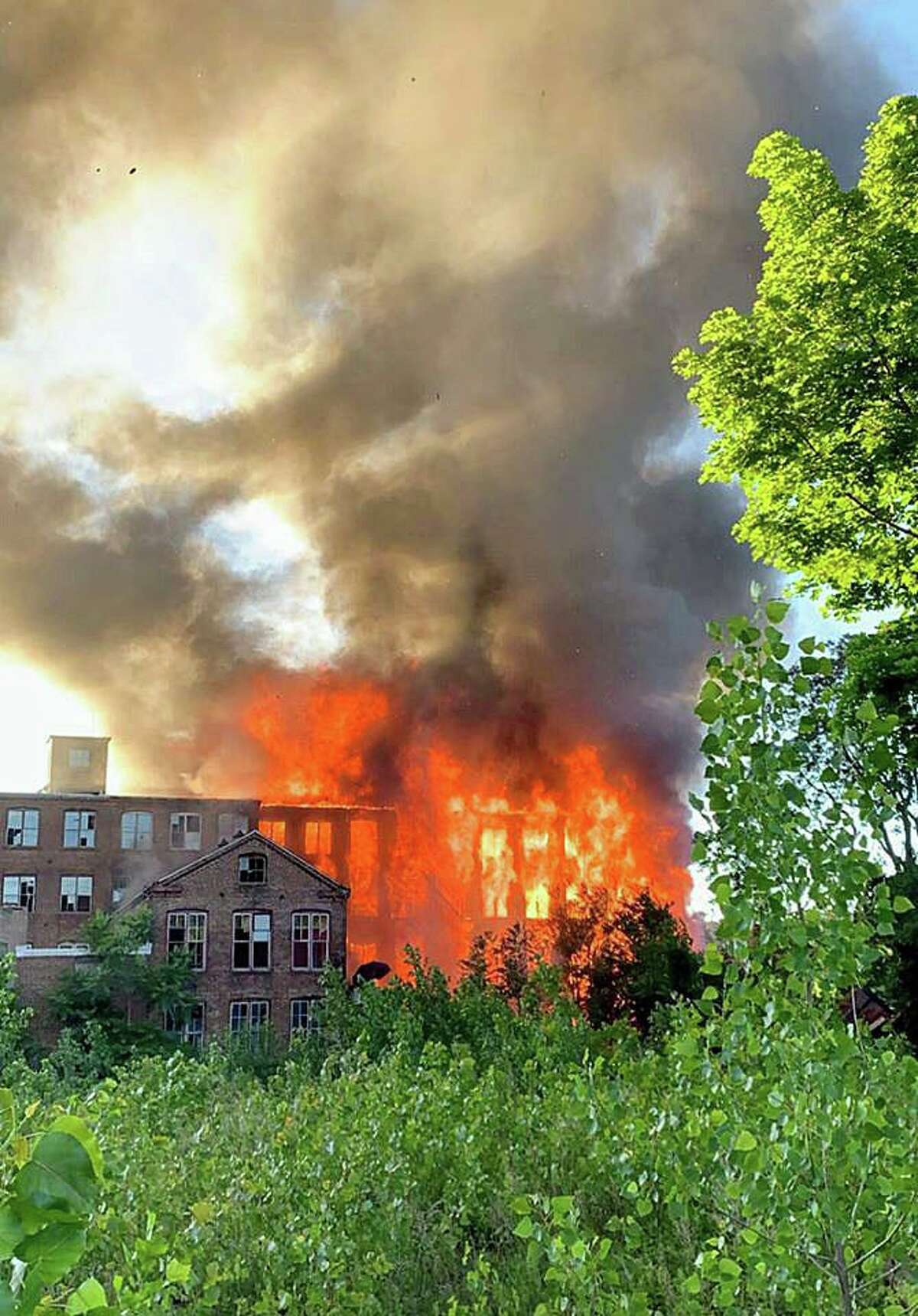 A massive fire tore through the the former Star Pin Co. in downtown Shelton on Saturday, June 13, 2020. Officials are investigating the cause of the fire in the vacant 19th-century buillding.