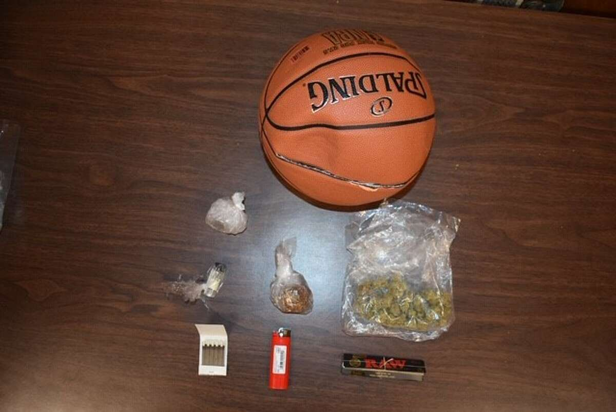 The Albany County Sheriff charged three people Sunday June 14, 2020 with felony prison contraband charges after this deflated basketball with items in it was allegedly thrown over a fence at the Albany County jail. The ball contained marijuana, loose tobacco, rolling papers, a lighter, matches and a small amount of tequila.