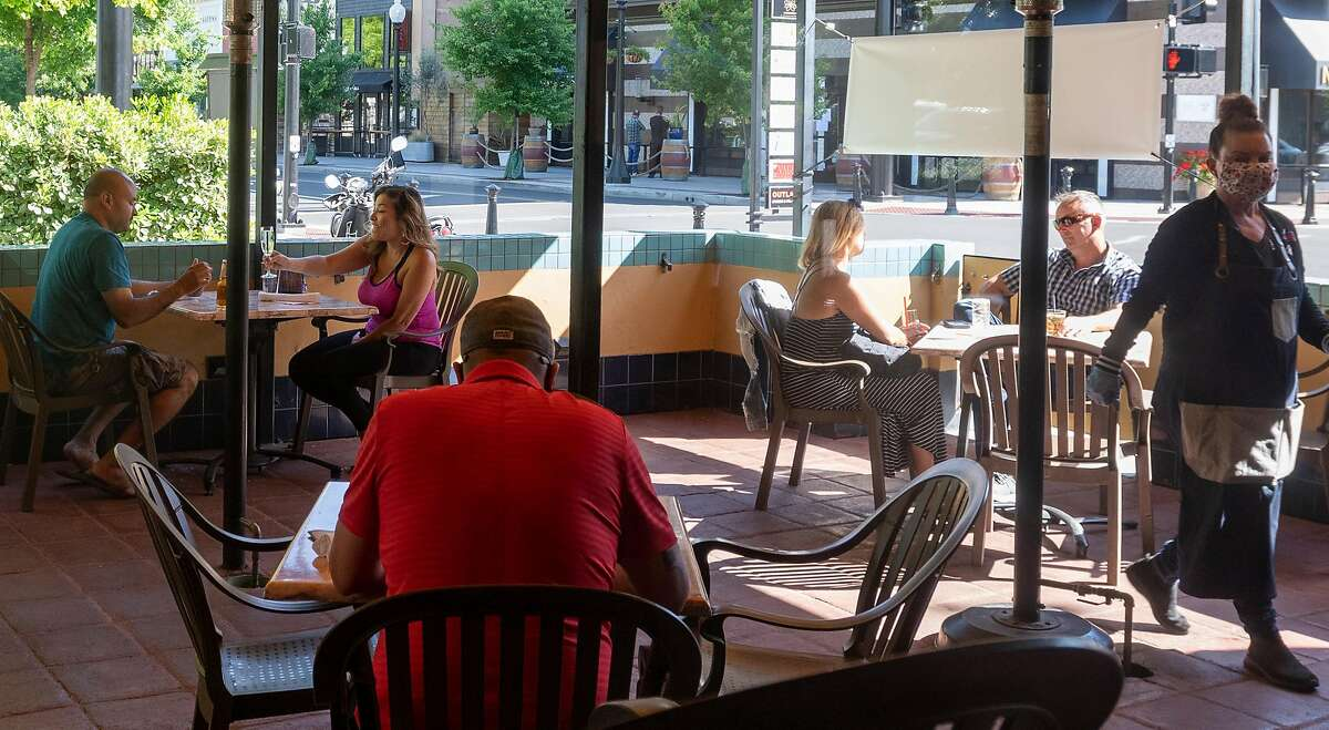Customers enjoy dining at Downtown Joe's restaurant and bar in Napa, California on May 20, 2020. Taking advantage of Napa's liberalized shelter-in-place rules, some restaurants have begun to fully reopen with new safety requirements in place.