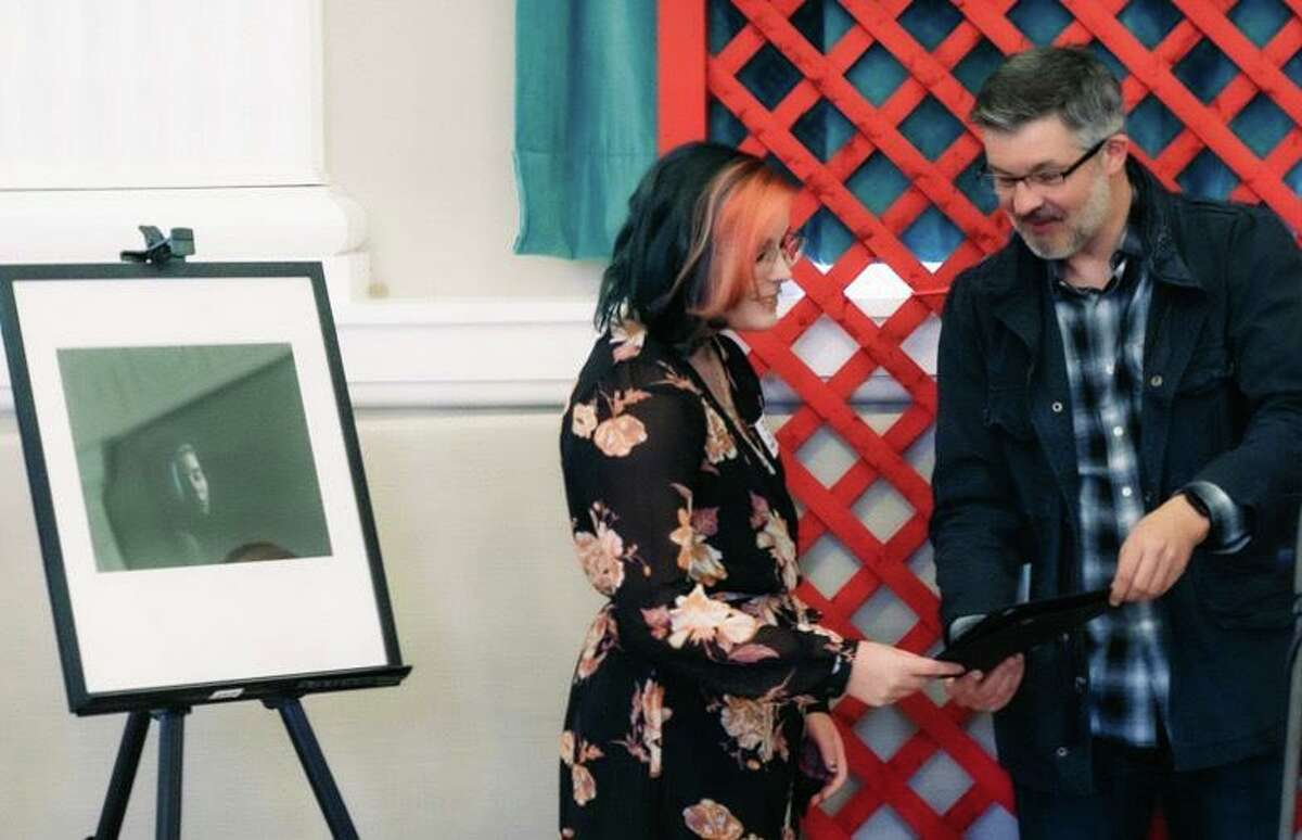 Ian Hockley presents the 2019 Dylan's Wings Photography Award to selected young photographer Jenna Velez, Woodland Regional High School.
